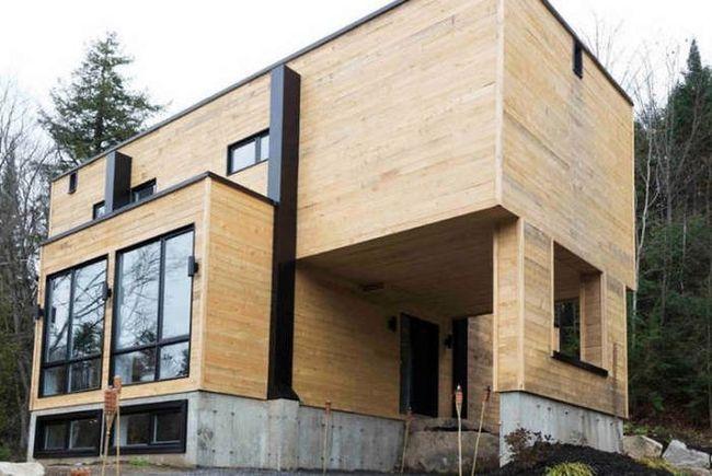 Симпатичный дом, построенный из морских контейнеров